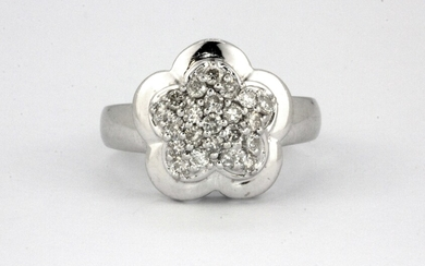 A 14ct white gold (stamped 585) diamond set flower shaped ring, (M).