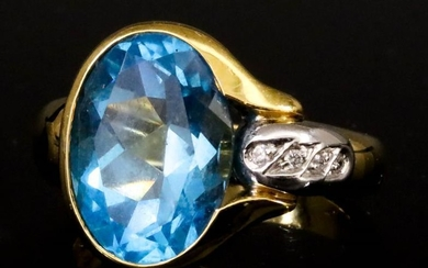 A Blue Topaz and Diamond Ring, Modern, in 18ct...