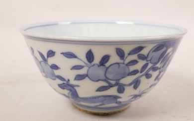 A Chinese blue and white porcelain rice bowl decorated with ...