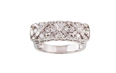A DIAMOND DRESS RING set with round brilliant cut and baguet...