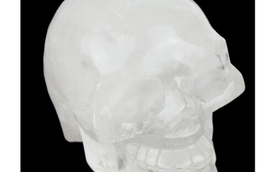 A LARGE ROCK CRYSTAL CARVED AS THE FORM OF A HUMAN SKULL. (w...
