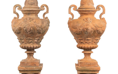 A Large Pair of Neoclassical Terra Cotta Covered Urns on Stands