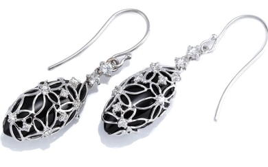 A PAIR OF 18CT WHITE GOLD ONYX AND DIAMOND DROP EARRINGS; navette shape drops of onyx in white gold daisy form framework set with ro...