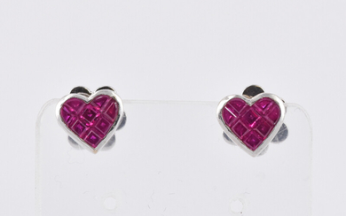 A PAIR OF RUBY AND GOLD EAR STUDS