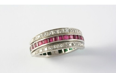 A RUBY, EMERALD AND DIAMOND SWIVEL ETERNITY RING set with ci...