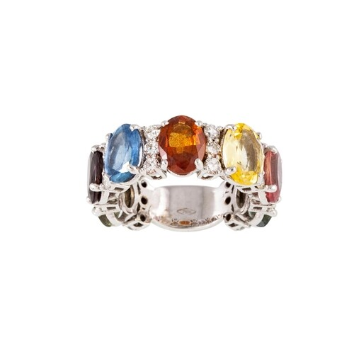 A SAPPHIRE AND DIAMOND DRESS RING, set with multi coloured o...