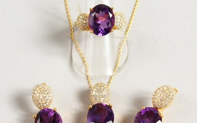 A SILVER AND GOLD PLATED THREE PIECE AMETHYST SET,