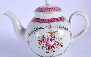 A STAFFORDSHIRE POTTERY TEA POT, painted with foliage.