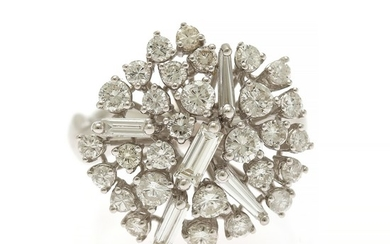 A diamond ring set with numerous brilliant-cut diamonds, three baguette-cut and two trapez-cut totalling app. 1.20 ct., mounted in 18k white gold. Size 53.
