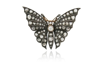 A diamond-set butterfly brooch, the rose-cut diamonds are...
