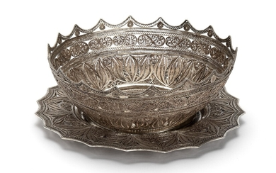 A filigrain silver basket on stand