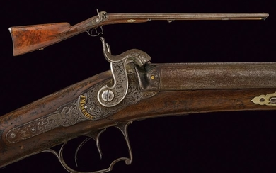 A fine double barreled percussion gun signed J....