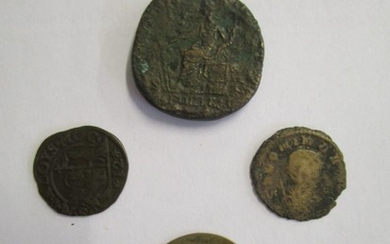 A group of four Roman coins to include a mid 18th century 1 ...