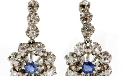 A pair of Continental platinum sapphire and diamond cluster earrings