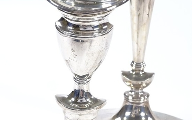 A pair of George V silver table candlesticks, shaped oval fo...