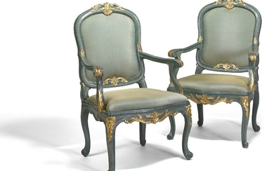 A pair of Venetian Rococo armchairs, green painted with giltwood carvings, loose drop-in seats and backs covered in green silk. Mid-18th century. (2)