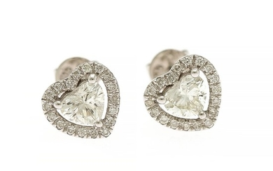 A pair of diamond ear studs each set with a heart shaped diamond encircled by numerous brilliant-cut diamonds, mounted in 18k white gold. (2)