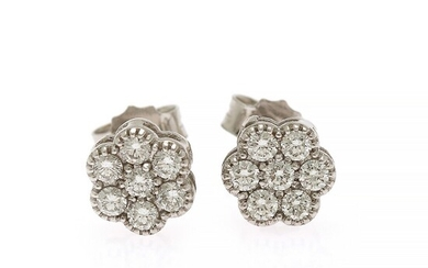 A pair of diamond ear studs each set with seven brilliant-cut diamonds totalling app. 0.36 ct., mounted in 18k white gold. Diam. app. 7 mm. (2)