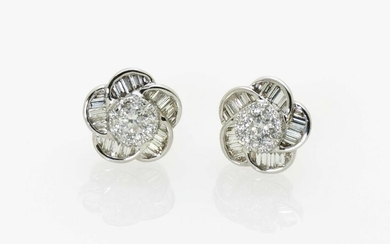A pair of flower-shaped stud earrings with brilliant