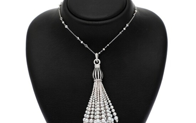 A pearl necklace set with numerous cultured pearls, sapphires and brilliant-cut diamonds, mounted in 18k white gold. L. app. 76 cm. (2)