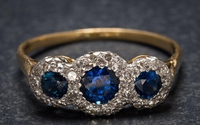 A sapphire and diamond triple cluster ring: the graduated ci...