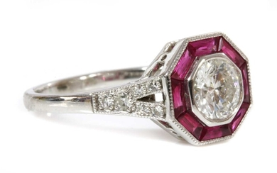A white gold diamond and ruby octagonal-shaped target cluster ring