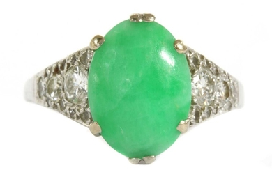 A white gold jade and diamond ring