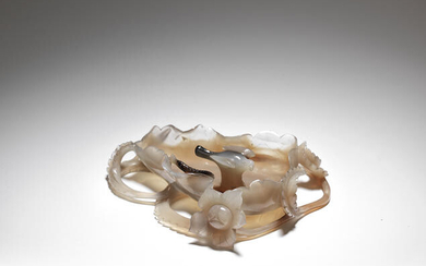 AN AGATE 'MAGPIE AND SNAKE' LOTUS-SHAPED WASHER