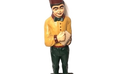 AN EARLY 20TH CENTURY AMERICAN CARVED AND PAINTED WOODEN FIG...
