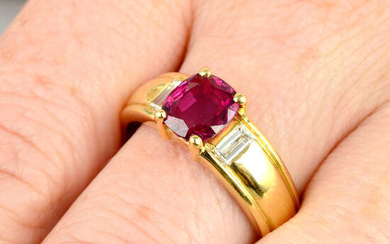 An 18ct gold Thai ruby single-stone ring, with baguette-cut diamond sides.