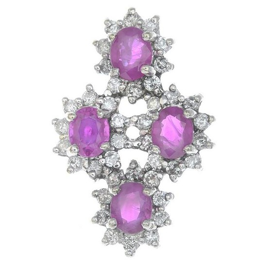 An 18ct gold ruby and diamond floral cluster