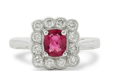 An 18ct white gold ruby and diamond cluster ring.