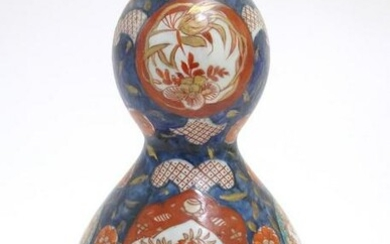 An Oriental double gourd vase in the Imari palette with