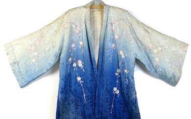 An early 20th century Japanese haori padded jacket, embroide...