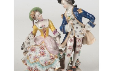 An early 20th century Naples figure group of a courting lady...