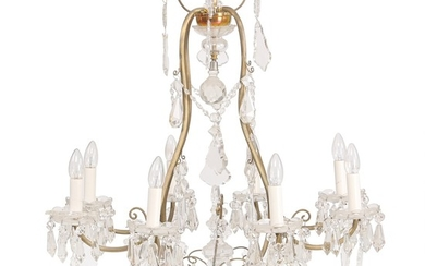 An eight-light crystal chandelier with bronze frame. Electrical. Ca. 1920. H. 100 cm. Diam. 80 cm.