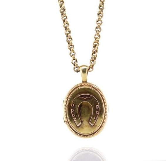 Antique yellow gold horse shoe locket and chain with applied...