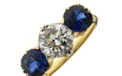 Diamond and sapphire three stone ring, the yellow mount...