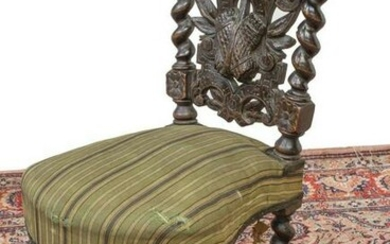 FRENCH CARVED OAK CIGAR CHAIR