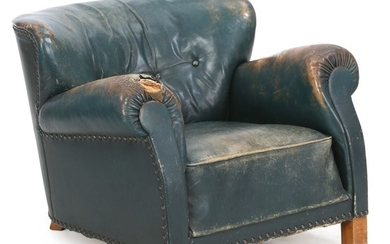 Fritz Hansen: Easy chair with stained beech legs. Upholstered with green leather fitted with nails. Model 1518.