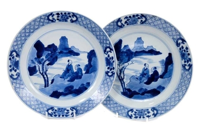 Good pair of Chinese blue and white porcelain dishes, each painted with two figures in a rocky landscape