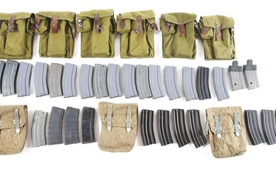 LARGE LOT OF AR-15 MAGAZINES AND POUCHES.