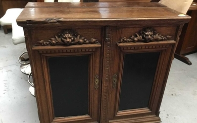 Late 19th century French carved oak cupboard with lions head and fruit decoration 86 cm wide, 79 cm high, 38 cm deep