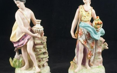 Pair Chelsea porcelain figures of a man and lady at a