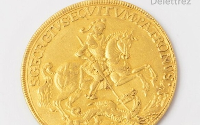 """Prophylactic amulet in yellow gold representing on the obverse Saint George on horseback slaying the dragon underlined with the phrase """"S GEORGIUS EQUITUM PATRONUS"""" or """"Saint George, patron saint of riders"""". On the reverse: two figures in a sailing..."""