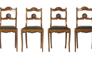 Set of four Louis Philippe chairs, mid 19th century, walnut, so-called sabre legs merging into a curved backrest, the backrest with carved shell motif and applied garlands of brass leaves, upholstered seat, h: 88 cm. Rest, normal signs of age and wear...