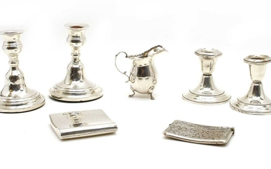 Silver items comprising two pairs of dwarf candlesticks