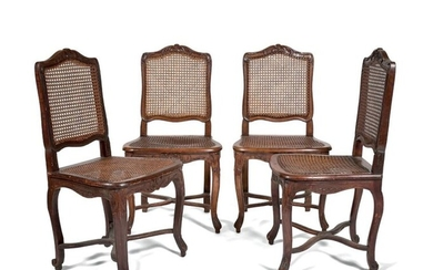 Suite of four dining room chairs in waxed natural wood...