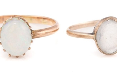 TWO VINTAGE 9CT GOLD STONE SET RINGS; set with an oval cabochon white opal with good play of colour (wear/ scratches) other with an...