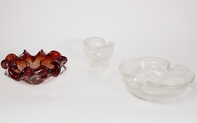 Two iridiscent clear ashtrays with bubbles and a red glass ashtray with bubbles